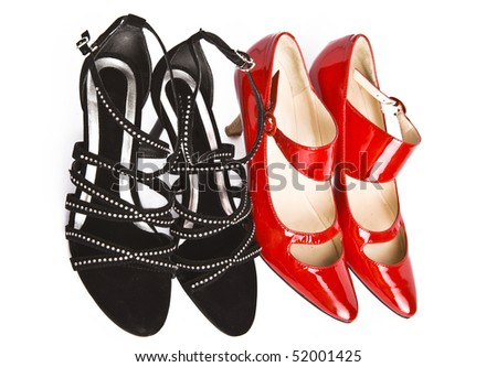 Female fashionable new shoes on a high heel of red and black color