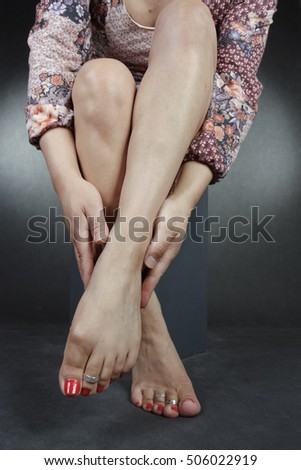 Female feet and flower over white background
