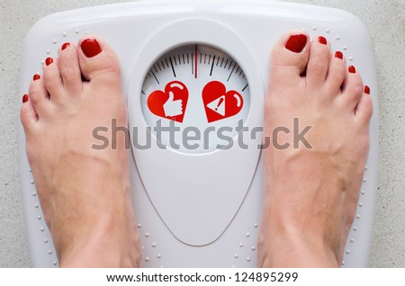 Female feet on bathroom scale with concept symbols for health care - stock photo