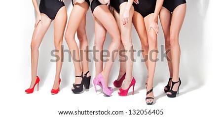 Female feet on the white - stock photo