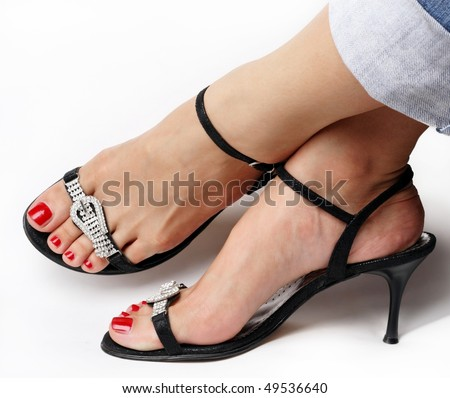 Female feet with fancy shoes - stock photo