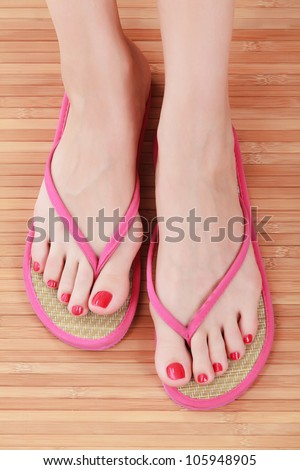 Female feet with flip-flops - stock photo