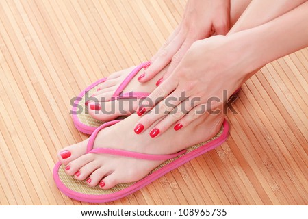 Female feet with flip-flops