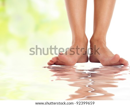 female feet with splayed fingers on water - spa and healthcare concept - stock photo