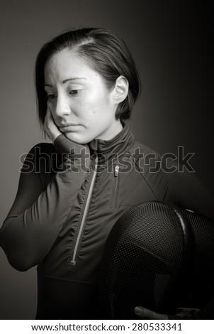 Female fencer looking sad - stock photo