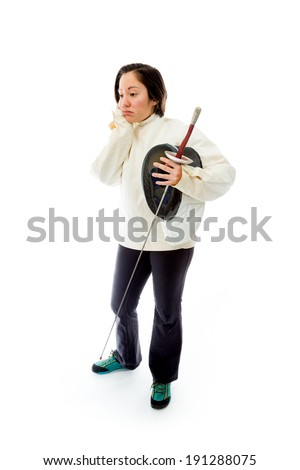 Female fencer looking sad with a holding mask and sword - stock photo
