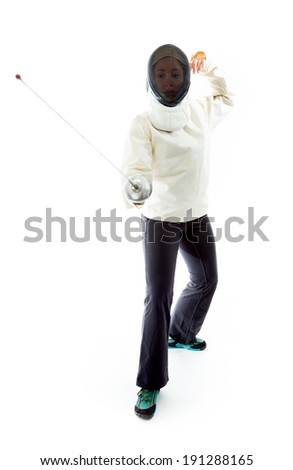 Female fencer practicing her fencing technique