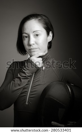 Female fencer thinking with hand on chin - stock photo