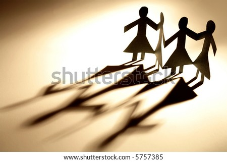 Female figures holding hands - stock photo