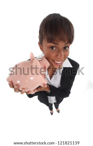 Female financial worker stood with piggy bank - stock photo