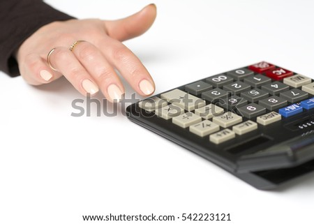 "Female finger presses the button ""equality"" on the calculator"