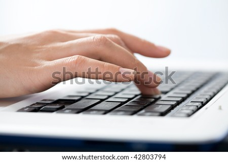 Female fingers typing a business document on the laptop