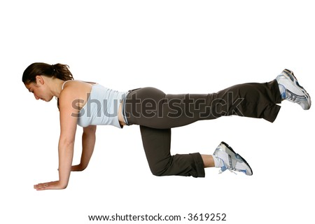 Female fitness trainer doing her leg raises, an exercise to strengthen the calf and thigh muscle, isolated on white. - stock photo