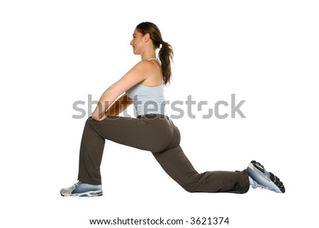 Female fitness trainer doing stretching for her calf and back of thigh muscle as part of warming down exercise, isolated on white. - stock photo