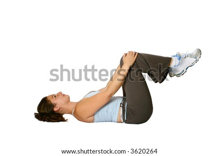 Female fitness trainer doing stretching for the muscle at the back of her thigh as part of winding down exercise, isolated on white. - stock photo