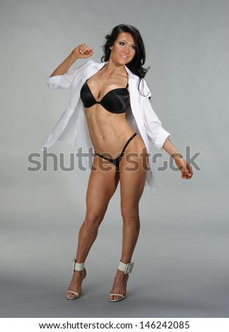 Female fitness woman in photo studio posing