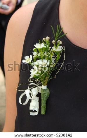Female Floral wedding buttonhole boutonniere - stock photo