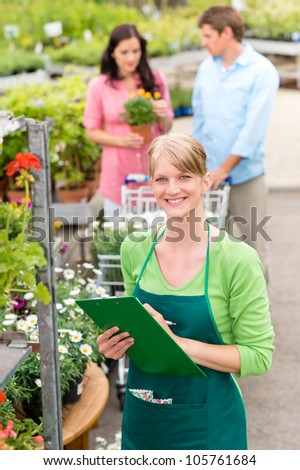 Female florist working at garden center do retail inventory