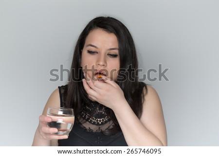 Female for pills inside - stock photo
