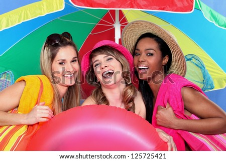 Female friends at the seaside - stock photo