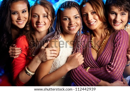 Female friends enjoying themselves at a bridal party - stock photo