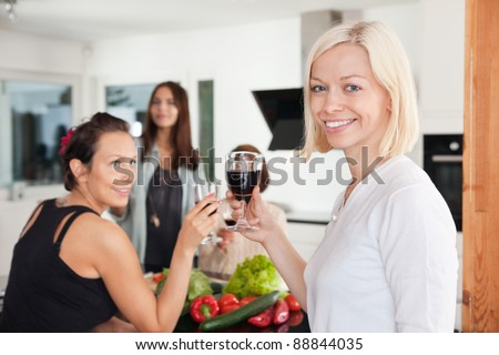 Female friends having a casual party at home - stock photo