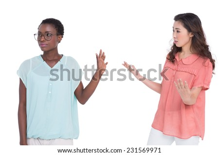 Female friends having a disagreement on white background - stock photo