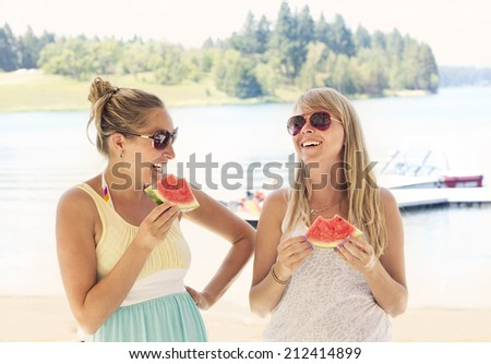 Female Friends laughing together at outdoor picnic