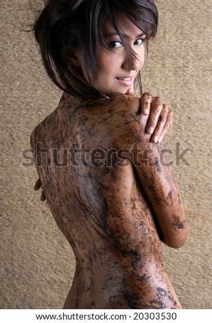 Female getting a body mud therapy - stock photo