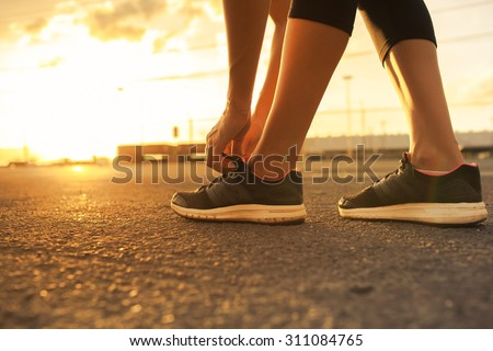 Female getting ready for a run early morning.  - stock photo