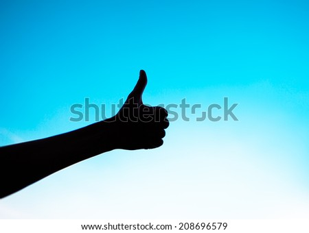 Female giving thumbs up. - stock photo