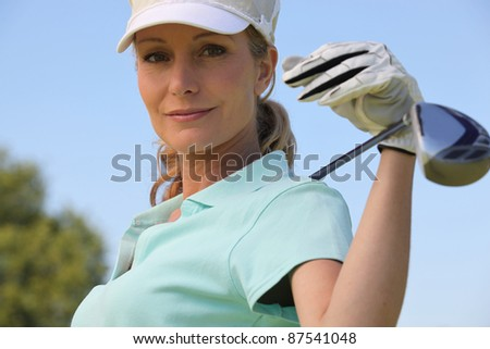 Female golf player - stock photo