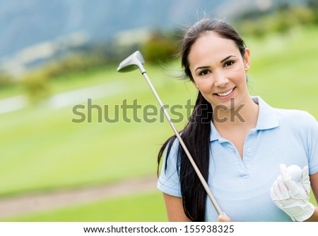 Female golf player at the course looking very happy  - stock photo