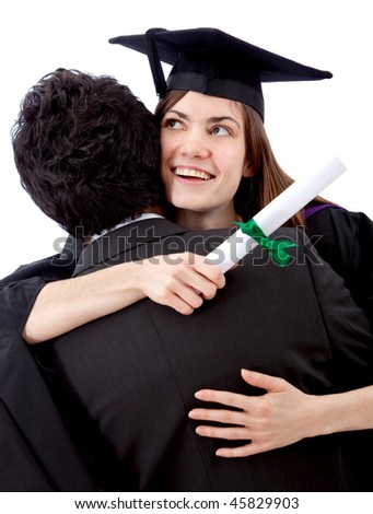 Female graduate hugging a man and celebrating - isolated - stock photo