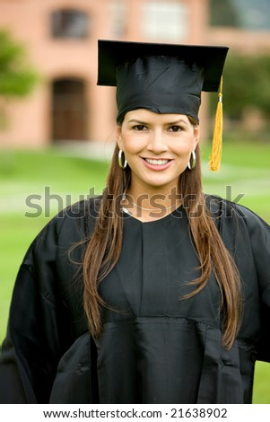 female graduate smiling and looking happy outdoors