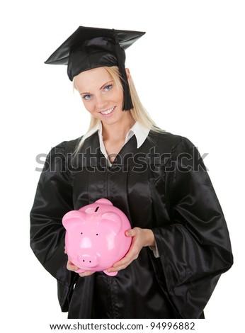 Female graduate student holding piggybank - stock photo
