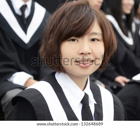 female graduation student on campus cheerful and happy - stock photo