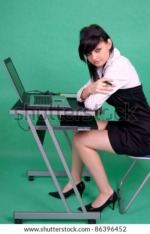 Female graphic designer with laptop and tablet pen. - stock photo