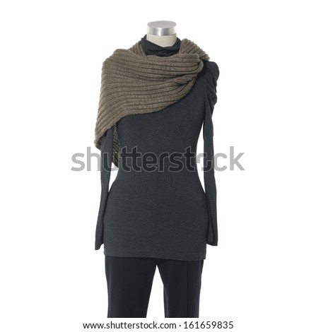 female gray shirt dress with scarf and trousers isolated on a dummy