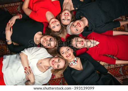 Female group,  women, happy, female ,woman, friends ,people, togethe, health, young, adult, smiling, portrait, smile, womens, beautiful, fun, cheerful, friendship, black, white, red, horns, hen-party - stock photo