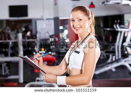 female gym instructor half length portrait - stock photo