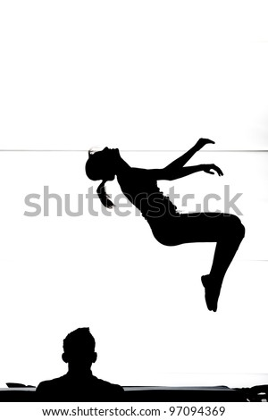 female gymnast on trampoline - stock photo