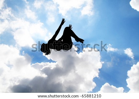 female gymnast silhouette jumping on trampoline in sky - stock photo