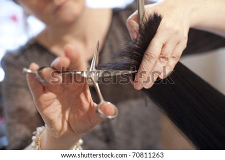 Female hairdresser in bright salon.