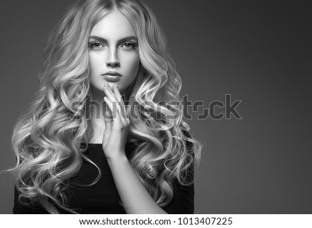 Female hairstyle long and cuerly black and white portrait over gray background