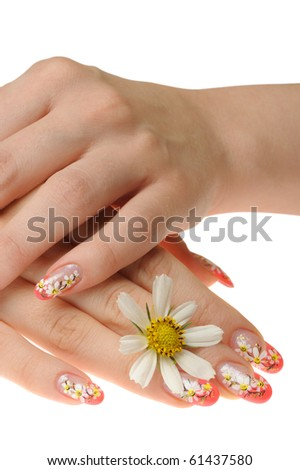 Female hand and flower. Nails with figure of a camomile