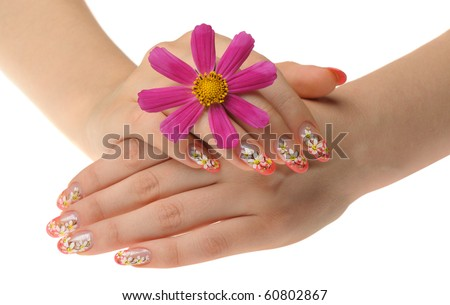 Female hand and flower. Nails with figure of a chamomile