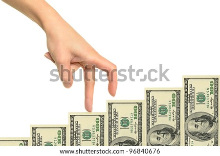 Female hand and money staircase isolated on white background - stock photo