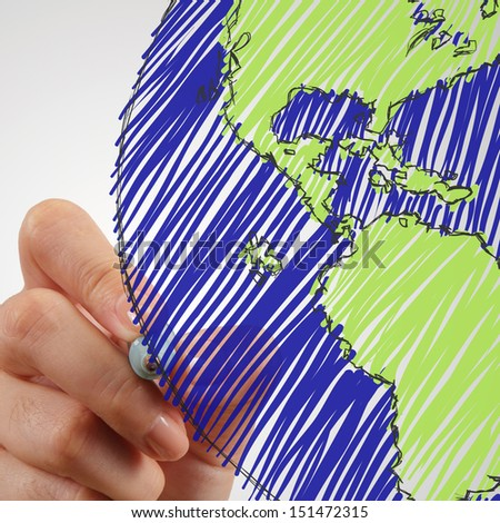 female hand drawing earth as concept - stock photo