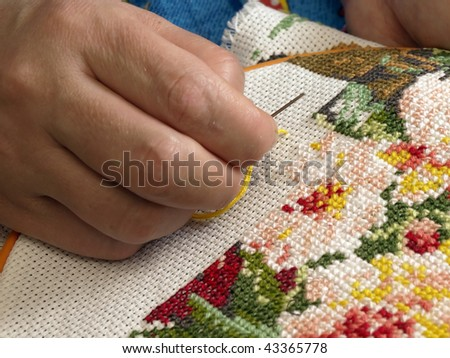 stock-photo-female-hand-embroider-at-cro